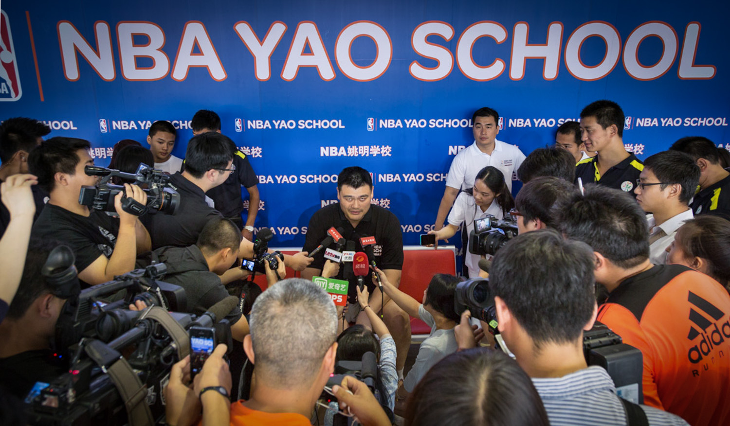 Yao Ming looks at me during a Press Conference for his basketball summer camp in Beijing