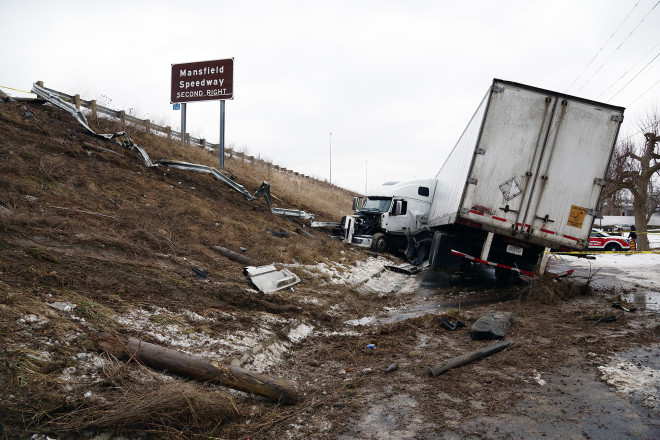 A semi sits on an embankment after going off U.S. 30 onto Crestline Ave.