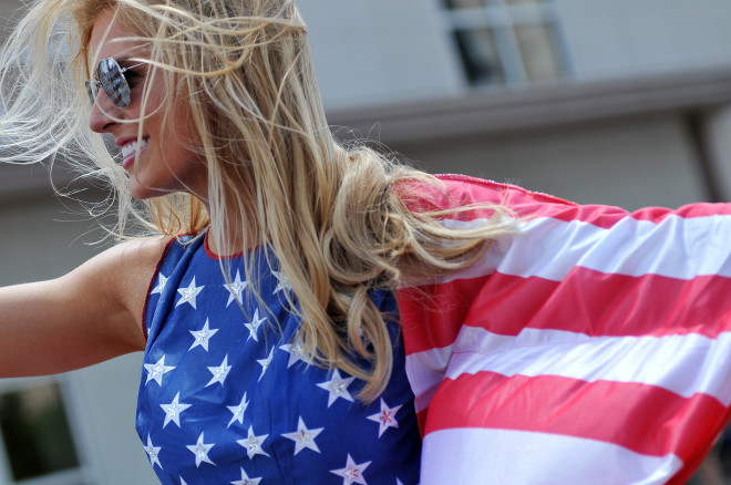 Miss Ohio contestant Veronica Wende shows off her Stars and Stripes during the Miss Ohio 2015 Parade in downtown Mansfield.