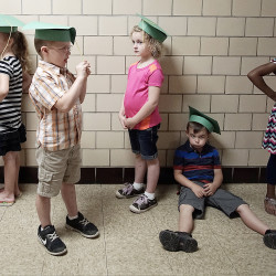 Children from Miss Kathleen's class wait in line to enter the auditorium before the Safety Town graduation ceremony at Brinkerhoff School.
