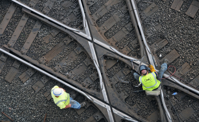 CSX workers perform maintence on railroad lines in downtown Crestline Monday, May 11th, 2015.