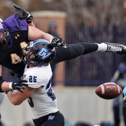 Ashland's Adam Shaheen and Grand Valley State's Garrett Pougnet get tangled up going for a pass during the NCAA Division II Super Region 4 quarterfinal at Jack Miller Stadium/Martinelli Field in Ashland.