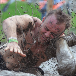 A participant gets a shoe in the face during the Tough Mudder Run at Mid-Ohio Sports Car Course Saturday, May 9th, 2015.