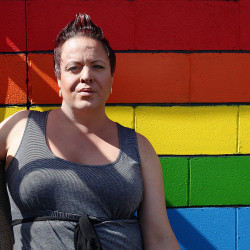Jasmyn LaBasha, organizer for the Mansfield Gay Pride Parade, poses for a photo outside of Sami's Bar.