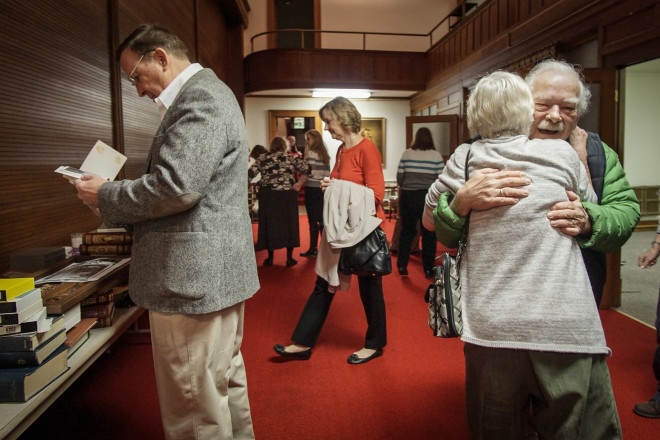 Parishioners say goodbye after the last service at the Church before the New Year.