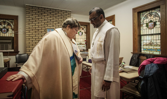 Reverend Marilou Brook and Assistant to the Bishop Terrance Jacob say a prayer before the last service at St. Matthew Lutheran Church.